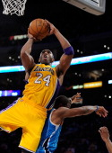 Kobe Bryant of the Los Angeles Lakers shoots a layup over Chris Paul of the New Orleans Hornets in Game Two of the Western Conference Quarterfinals...