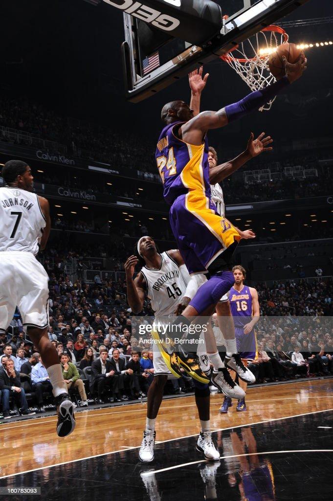 Kobe Bryant #24 of the Los Angeles Lakers shoots a reverse layup against the Brooklyn Nets on February 5, 2013 at the Barclays Center in the Brooklyn borough of New York City.