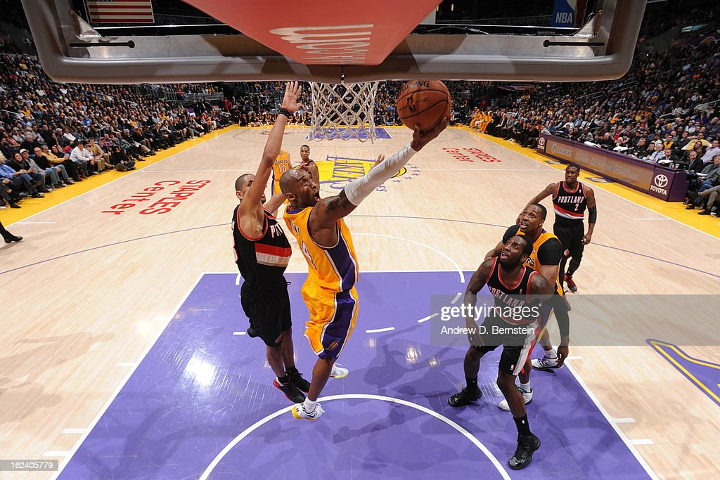 Kobe Bryant #24 of the Los Angeles Lakers shoots a reverse layup against Nicolas Batum #88 of the Portland Trail Blazers at Staples Center on February 22, 2013 in Los Angeles, California.