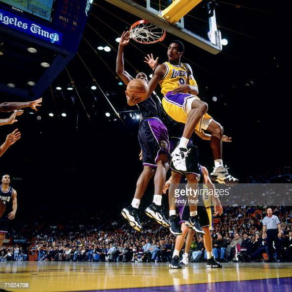 Kobe Bryant of the Los Angeles Lakers shoots a reverse layup against the Sacramento Kings during a game at The Great Western Forum on May 25 1998 in...
