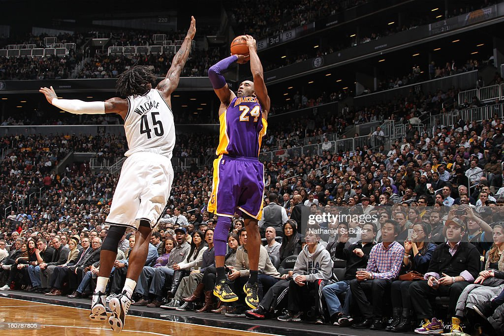 Kobe Bryant #24 of the Los Angeles Lakers shoots a three pointer against Gerald Wallace #45 of the Brooklyn Nets on February 5, 2013 at the Barclays Center in the Brooklyn borough of New York City.