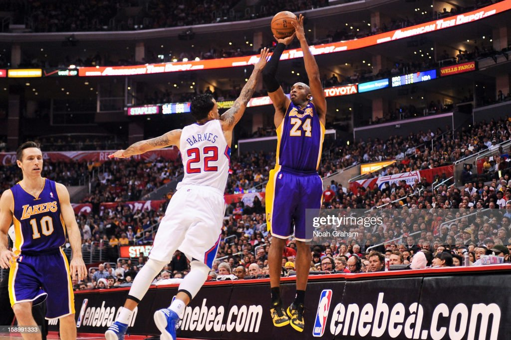 Kobe Bryant #24 of the Los Angeles Lakers shoots a three-pointer against Matt Barnes #22 of the Los Angeles Clippers at Staples Center on January 4, 2013 in Los Angeles, California.