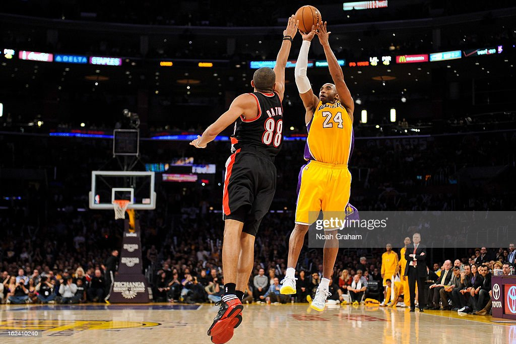 <a gi-track='captionPersonalityLinkClicked' href=/galleries/search?phrase=Kobe+Bryant&family=editorial&specificpeople=201466 ng-click='$event.stopPropagation()'>Kobe Bryant</a> #24 of the Los Angeles Lakers shoots a three-pointer against <a gi-track='captionPersonalityLinkClicked' href=/galleries/search?phrase=Nicolas+Batum&family=editorial&specificpeople=3746275 ng-click='$event.stopPropagation()'>Nicolas Batum</a> #88 of the Portland Trail Blazers at Staples Center on February 22, 2013 in Los Angeles, California.