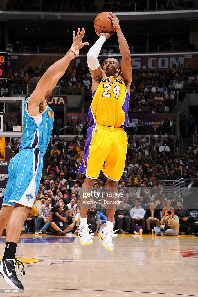Kobe Bryant #24 of the Los Angeles Lakers shoots a three-pointer against the New Orleans Hornets at Staples Center on April 9, 2013 in Los Angeles, California.