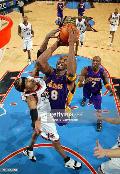 Kobe Bryant of the Los Angeles Lakers shoots against Allen Iverson of the Philadelphia 76ers on November 11 2005 at the Wachovia Center in...