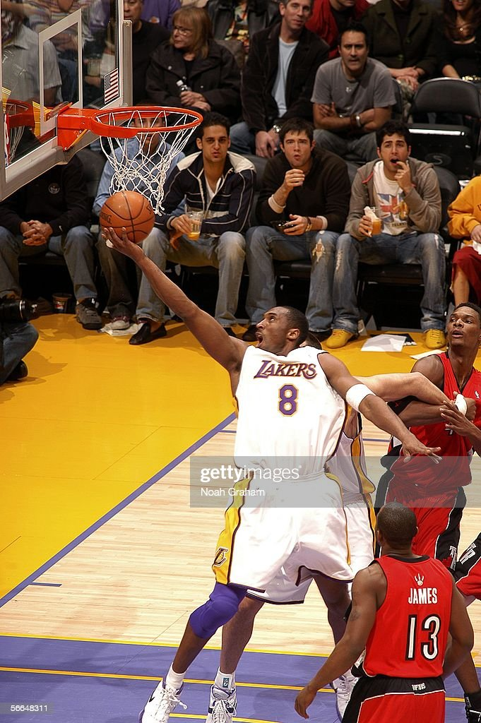 <a gi-track='captionPersonalityLinkClicked' href=/galleries/search?phrase=Kobe+Bryant&family=editorial&specificpeople=201466 ng-click='$event.stopPropagation()'>Kobe Bryant</a> #8 of the Los Angeles Lakers shoots against Chris Bosh #4 and Mike James #13 of the Toronto Raptors on January 22, 2006 at Staples Center in Los Angeles, California.