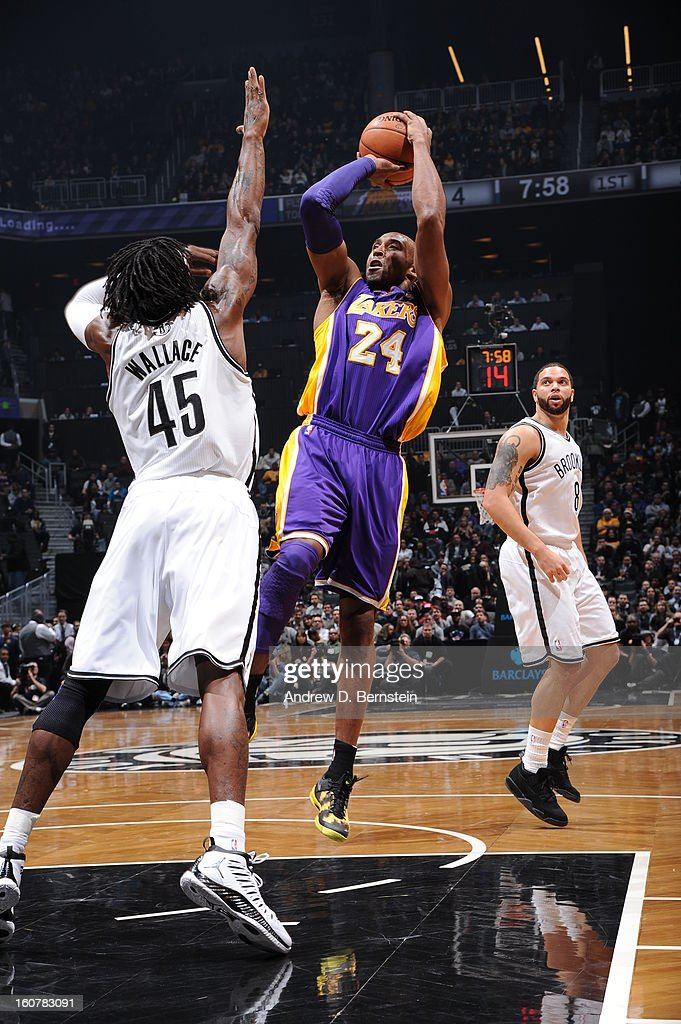 Kobe Bryant #24 of the Los Angeles Lakers shoots against Gerald Wallace #45 of the Brooklyn Nets on February 5, 2013 at the Barclays Center in the Brooklyn borough of New York City.