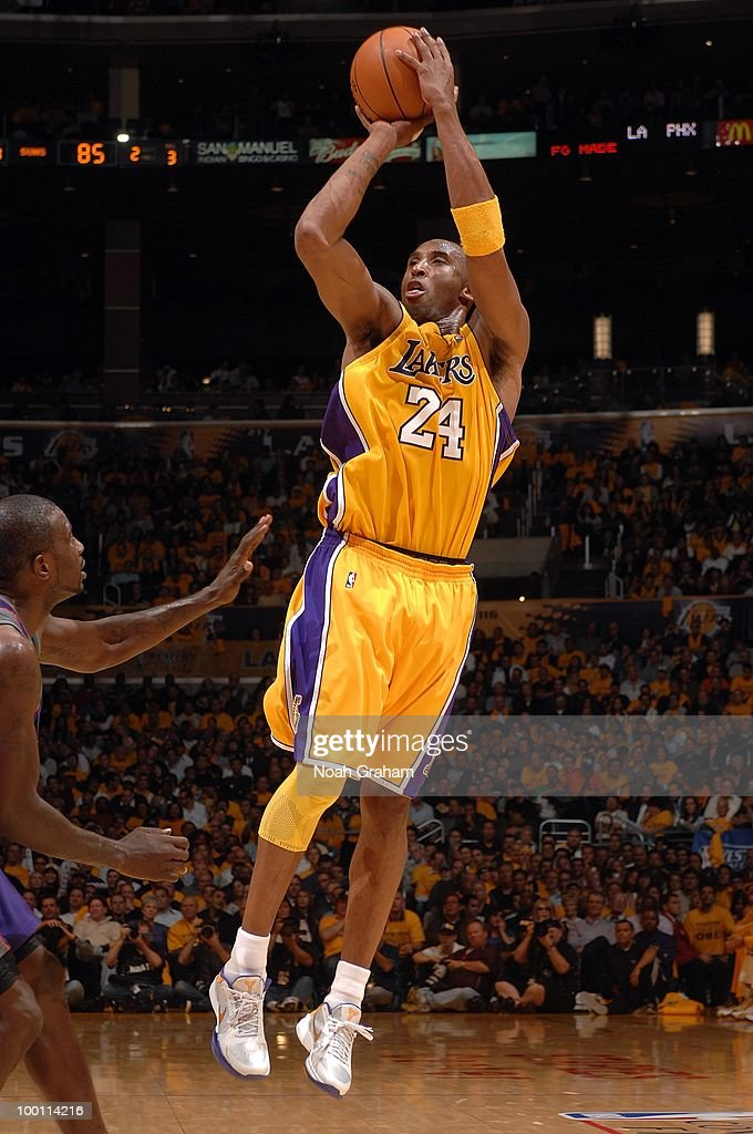 Kobe Bryant of the Los Angeles Lakers shoots against Jason Richardson of the Phoenix Suns in Game One of the Western Conference Finals during the...