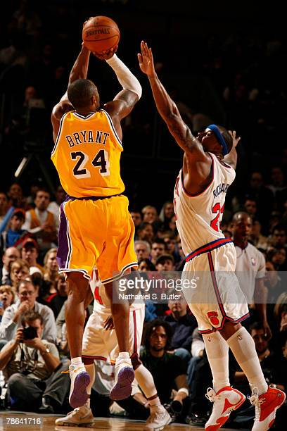 Kobe Bryant of the Los Angeles Lakers shoots against Quentin Richardson of the New York Knicks on December 23 2007 at Madison Square Garden in New...