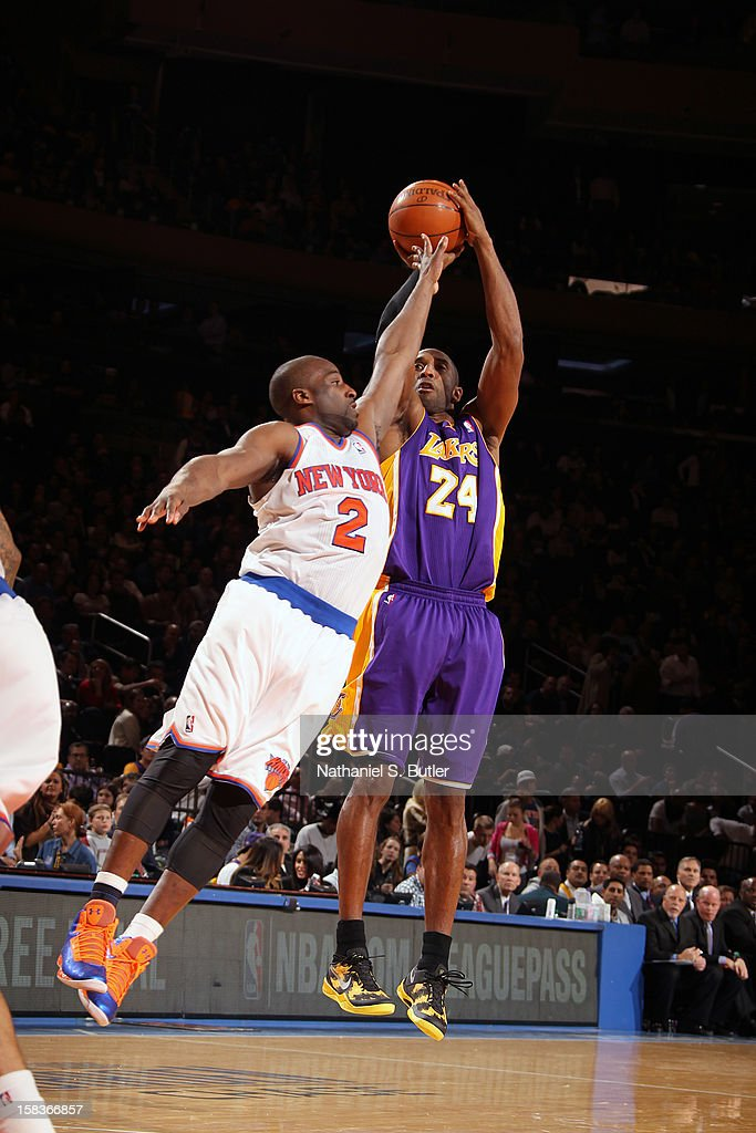 Kobe Bryant #24 of the Los Angeles Lakers shoots against Raymond Felton #2 of the New York Knicks on December 13, 2012 at Madison Square Garden in New York City.