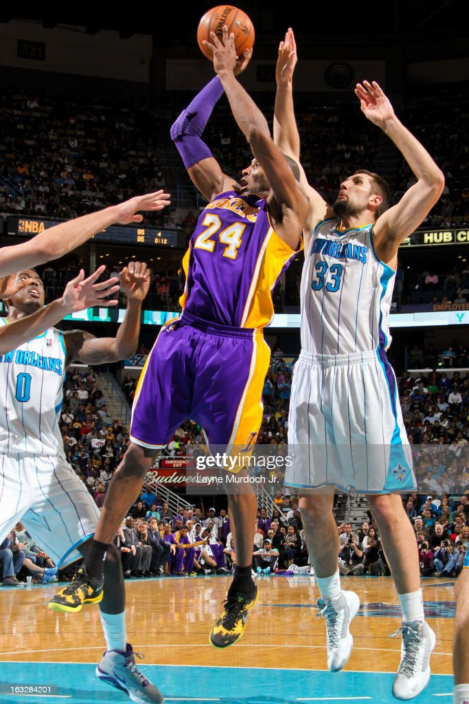Kobe Bryant #24 of the Los Angeles Lakers shoots in the lane against Ryan Anderson #33 of the New Orleans Hornets on March 6, 2013 at the New Orleans Arena in New Orleans, Louisiana.