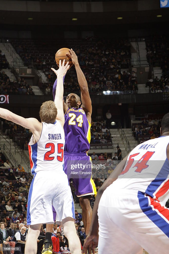Kobe Bryant #24 of the Los Angeles Lakers shoots over against Kyle Singler #25 of the Detroit Pistons during the game on February 3, 2013 at The Palace of Auburn Hills in Auburn Hills, Michigan.