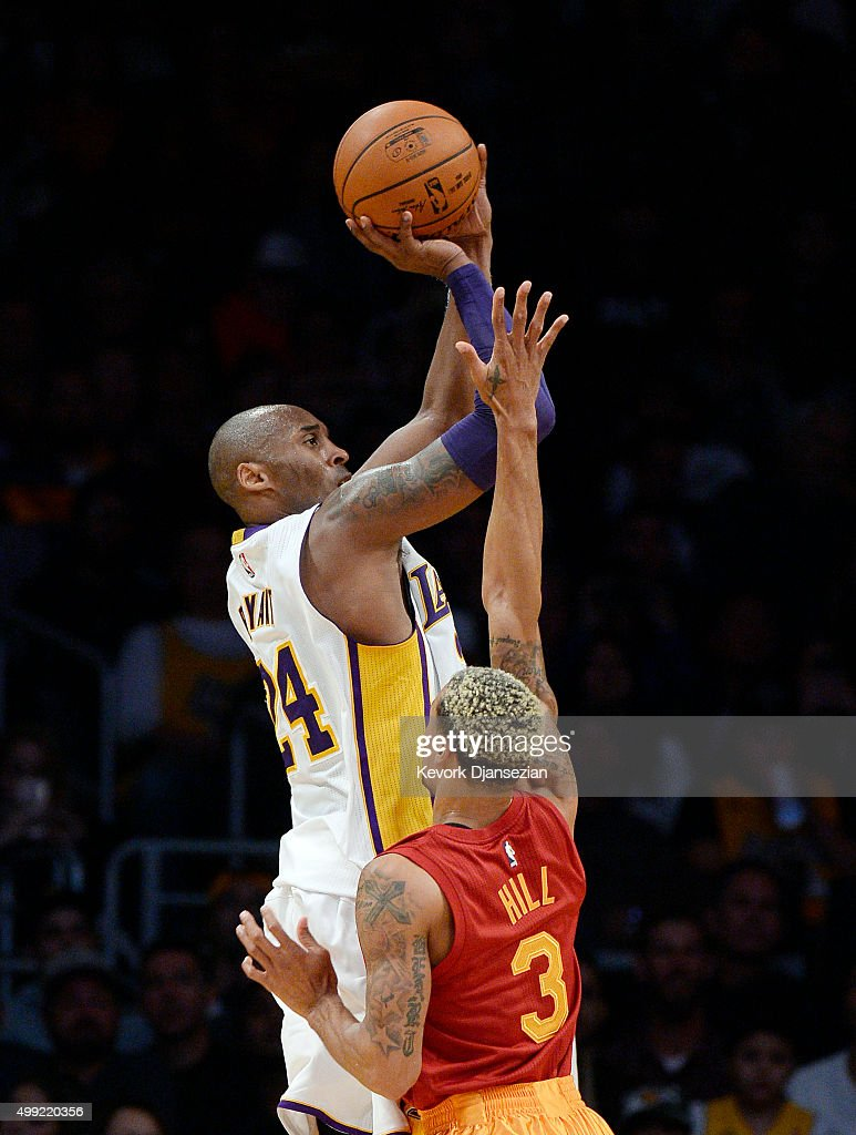 Kobe Bryant #24 of the Los Angeles Lakers shoots over George Hill #3 of the Indiana Pacers asks during the first half of the basketball at Staples Center November 29, 2015, in Los Angeles, California. Bryant announced the he will retire from the NBA at the end of the 2015-16 season.
