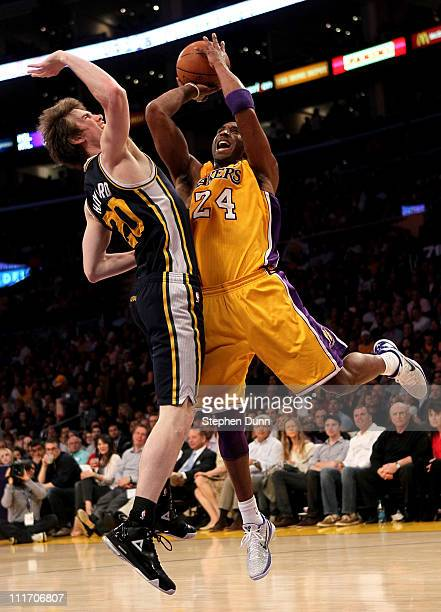 Kobe Bryant of the Los Angeles Lakers shoots over Gordon Hayward of the Utah Jazz at Staples Center on April 5 2011 in Los Angeles California The...