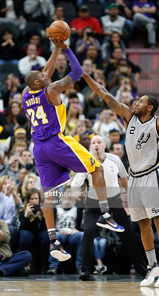 <a gi-track='captionPersonalityLinkClicked' href=/galleries/search?phrase=Kobe+Bryant&family=editorial&specificpeople=201466 ng-click='$event.stopPropagation()'>Kobe Bryant</a> #24 of the Los Angeles Lakers shoots over <a gi-track='captionPersonalityLinkClicked' href=/galleries/search?phrase=Kawhi+Leonard&family=editorial&specificpeople=6691012 ng-click='$event.stopPropagation()'>Kawhi Leonard</a> #2 of the San Antonio Spurs at AT&T Center on February 6, 2016 in San Antonio, Texas.