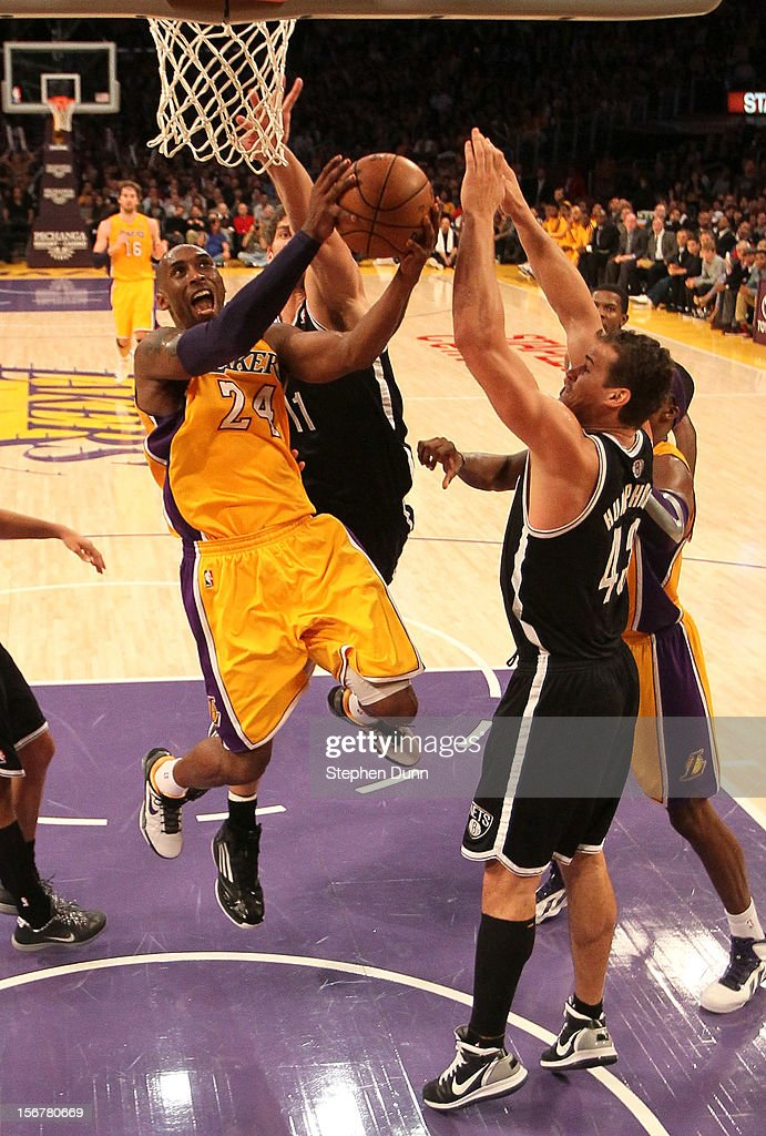 <a gi-track='captionPersonalityLinkClicked' href=/galleries/search?phrase=Kobe+Bryant&family=editorial&specificpeople=201466 ng-click='$event.stopPropagation()'>Kobe Bryant</a> #24 of the Los Angeles Lakers shoots over <a gi-track='captionPersonalityLinkClicked' href=/galleries/search?phrase=Kris+Humphries&family=editorial&specificpeople=209199 ng-click='$event.stopPropagation()'>Kris Humphries</a> #43 of the Brooklyn Nets at Staples Center on November 20, 2012 in Los Angeles, California. The Lakers won 95-90.