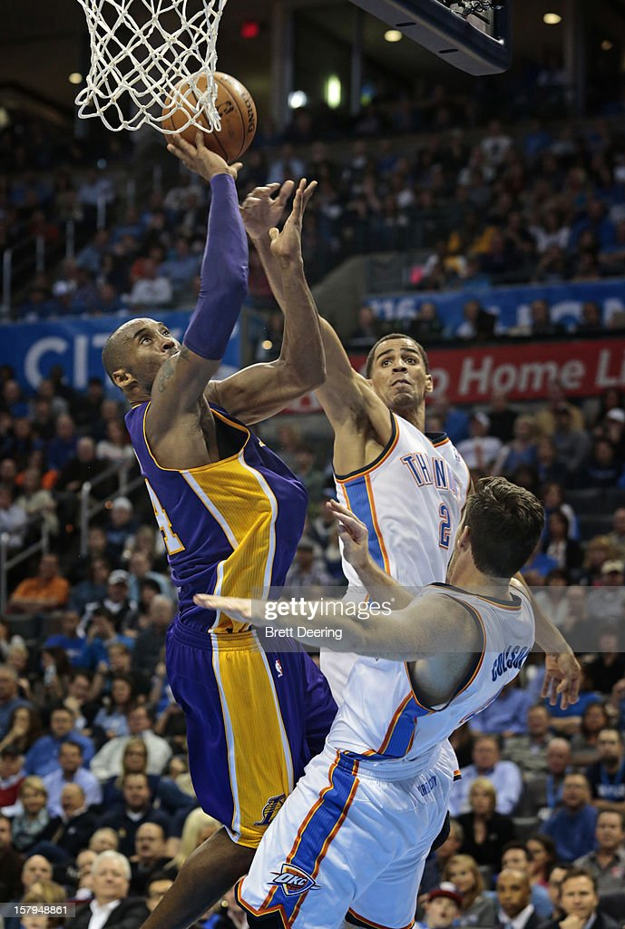 Kobe Bryant #24 of the Los Angeles Lakers shoots over Thabo Sefolosha #2 and Nick Collison #4 of the Oklahoma City Thunder December 7, 2012 at Chesapeake Energy Arena in Oklahoma City, Oklahoma. Oklahoma City defeated Los Angeles 114-108.