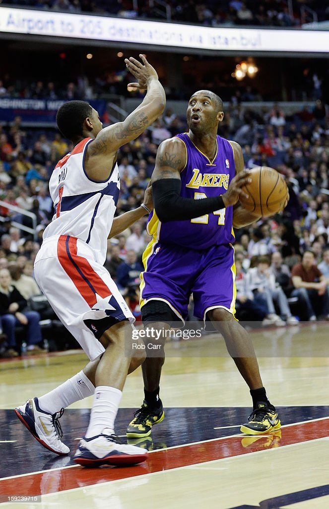 <a gi-track='captionPersonalityLinkClicked' href=/galleries/search?phrase=Kobe+Bryant&family=editorial&specificpeople=201466 ng-click='$event.stopPropagation()'>Kobe Bryant</a> #24 of the Los Angeles Lakers shoots over <a gi-track='captionPersonalityLinkClicked' href=/galleries/search?phrase=Trevor+Ariza&family=editorial&specificpeople=201708 ng-click='$event.stopPropagation()'>Trevor Ariza</a> #1 of the Washington Wizards at Verizon Center on December 14, 2012 in Washington, DC.