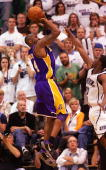 Kobe Bryant of the Los Angeles Lakers shoots over Wesley Matthews of the Utah Jazz during Game Three of the Western Conference Semifinals of the 2010...