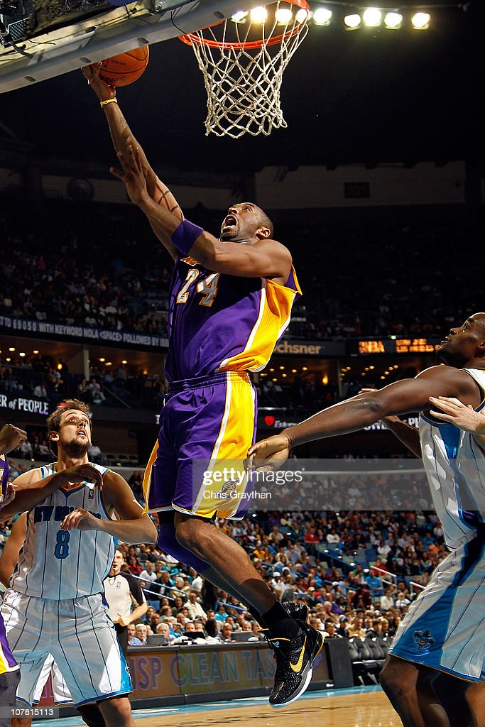 Kobe Bryant of the Los Angeles Lakers shoots the ball over Emeka Okafor of the New Orleans Hornets at the New Orleans Arena on December 29 2010 in...