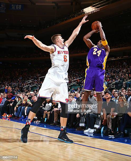 Kobe Bryant of the Los Angeles Lakers shoots the ball over Kristaps Porzingis of the New York Knicks on November 8 2015 at Madison Square Garden in...