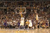 Kobe Bryant of the Los Angeles Lakers shoots the buzzer beating game winning shot in overtime against the Phoenix Suns in game four of the Western...