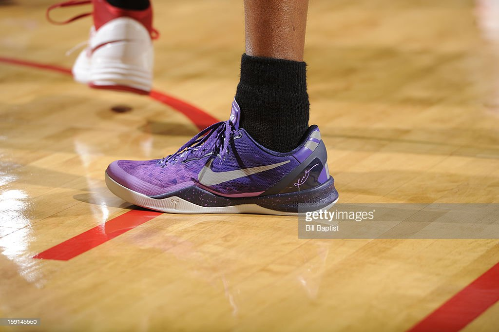Kobe Bryant #24 of the Los Angeles Lakers shows off his shoes during the games against the Houston Rockets on January 8, 2013 at the Toyota Center in Houston, Texas.