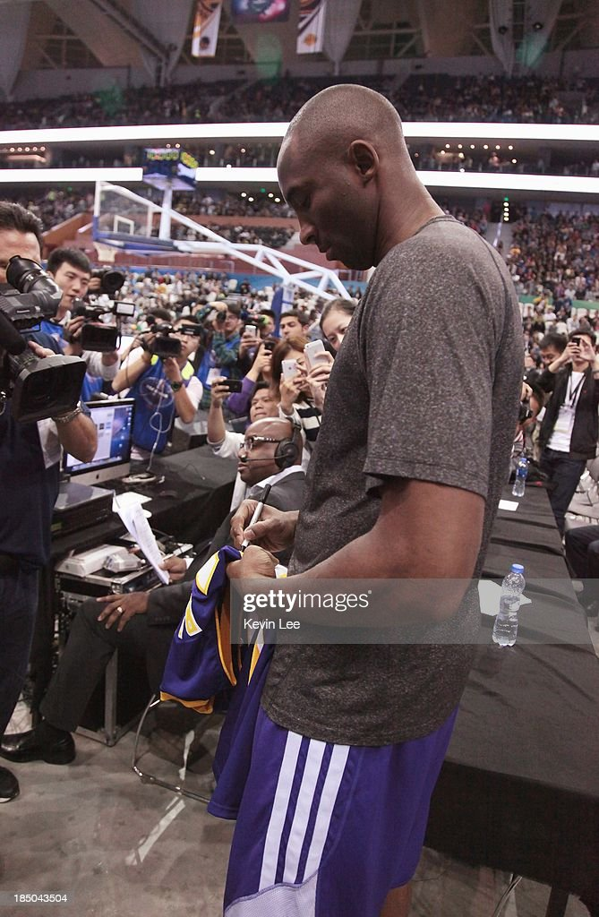 <a gi-track='captionPersonalityLinkClicked' href=/galleries/search?phrase=Kobe+Bryant&family=editorial&specificpeople=201466 ng-click='$event.stopPropagation()'>Kobe Bryant</a> of the Los Angeles Lakers signs a T-shirt for a fan at NBA Fans Appreciation day on October 17, 2013 in Shanghai, China.