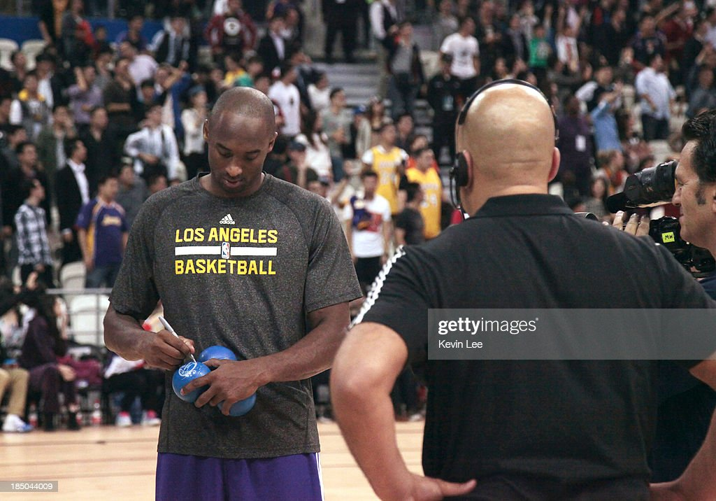 <a gi-track='captionPersonalityLinkClicked' href=/galleries/search?phrase=Kobe+Bryant&family=editorial&specificpeople=201466 ng-click='$event.stopPropagation()'>Kobe Bryant</a> of the Los Angeles Lakers signs autographs for fans at NBA Fan Appreciation day on October 17, 2013 in Shanghai, China.
