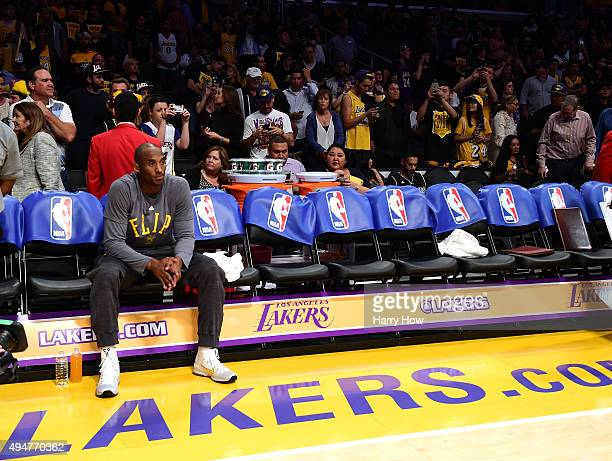 Kobe Bryant of the Los Angeles Lakers sits on the bench before the opening season game against the Minnesota Timberwolves at Staples Center on...