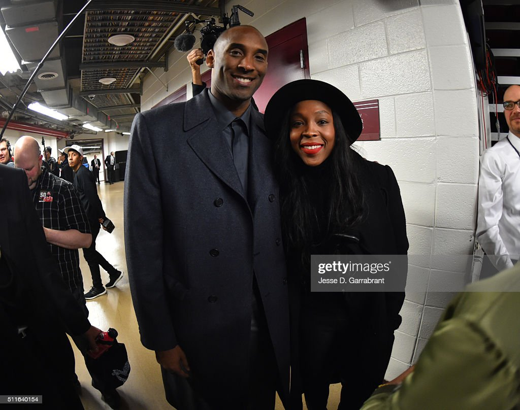 <a gi-track='captionPersonalityLinkClicked' href=/galleries/search?phrase=Kobe+Bryant&family=editorial&specificpeople=201466 ng-click='$event.stopPropagation()'>Kobe Bryant</a> #24 of the Los Angeles Lakers smiles for a picture with <a gi-track='captionPersonalityLinkClicked' href=/galleries/search?phrase=Cappie+Pondexter&family=editorial&specificpeople=544600 ng-click='$event.stopPropagation()'>Cappie Pondexter</a> of the Chicago Sky after the game against the Chicago Bulls on February 21, 2016 at the United Center in Chicago, Illinois.