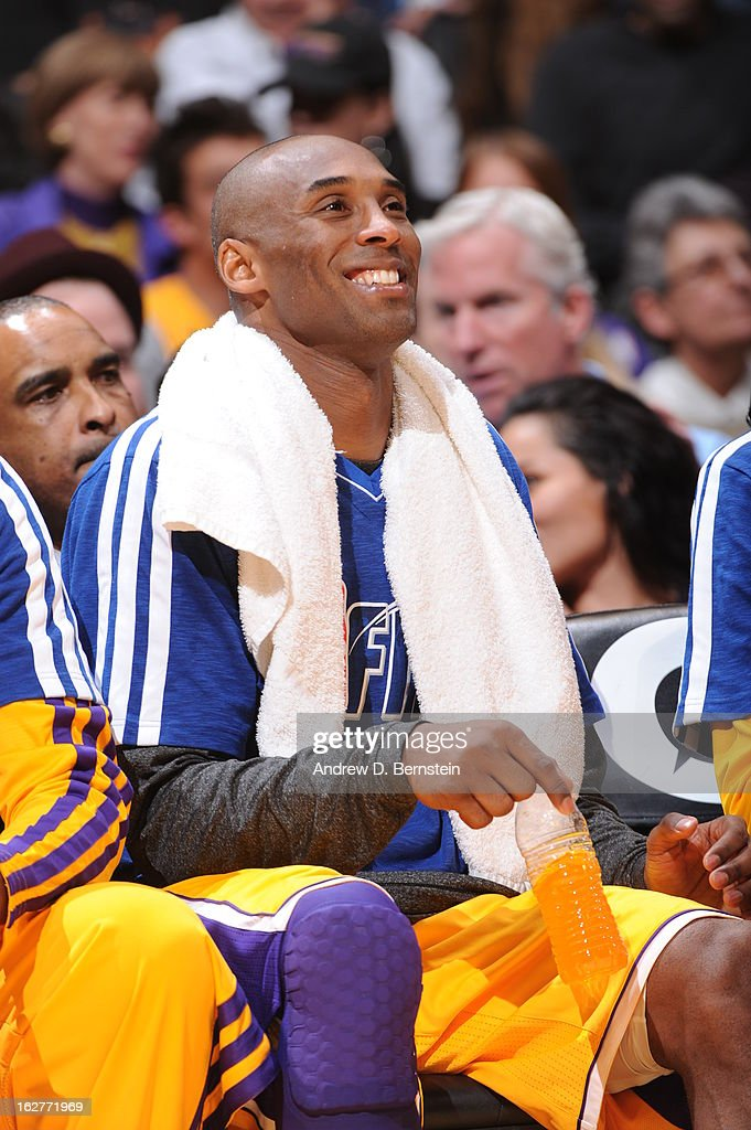 Kobe Bryant #24 of the Los Angeles Lakers smiles on the bench during the game against the New Orleans Hornets at Staples Center on January 29, 2013 in Los Angeles, California.