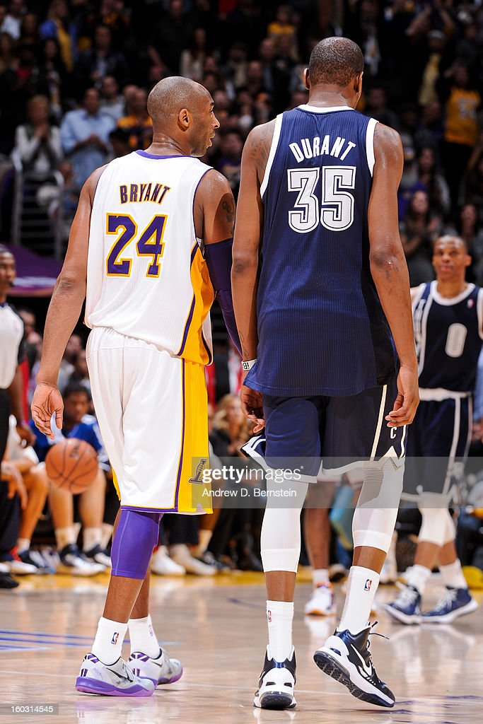 Kobe Bryant #24 of the Los Angeles Lakers speaks with Kevin Durant #35 of the Oklahoma City Thunder during their game at Staples Center on January 27, 2013 in Los Angeles, California.