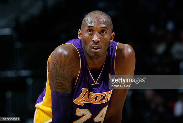 Kobe Bryant of the Los Angeles Lakers stands during a free throw against the Atlanta Hawks at Philips Arena on December 16 2013 in Atlanta Georgia...