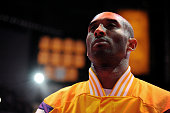 Kobe Bryant of the Los Angeles Lakers stands for the national anthem before a game against the Miami Heat on January 13 2015 in Los Angeles...