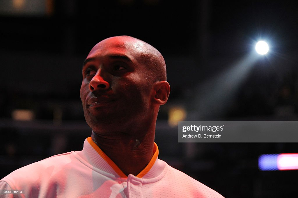 Kobe Bryant #24 of the Los Angeles Lakers stands for the national anthem before the game against the Indiana Pacers on November 29, 2015 at STAPLES Center in Los Angeles, California.
