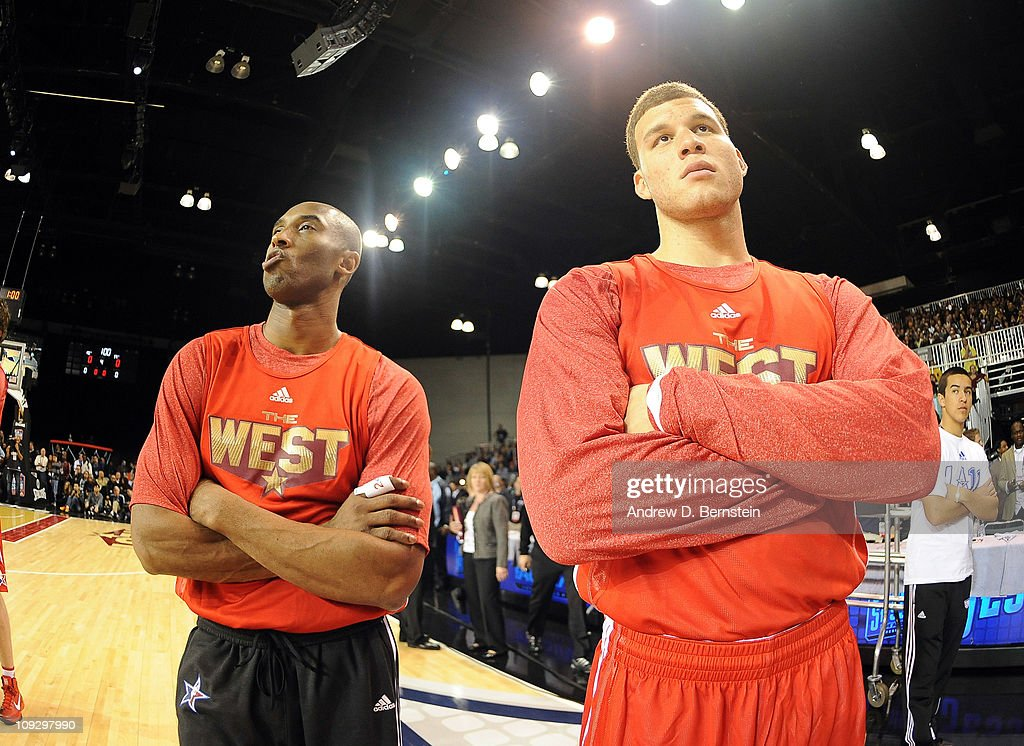 Kobe Bryant of the Los Angeles Lakers stands with Blake Griffin of the Los Angeles Clippers during the East West AllStar Practice on center Court at...