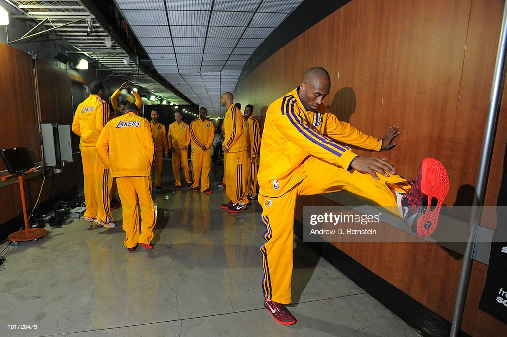 Kobe Bryant #24 of the Los Angeles Lakers stretches in the hallway before facing the Los Angeles Clippers at Staples Center on February 14, 2013 in Los Angeles, California.