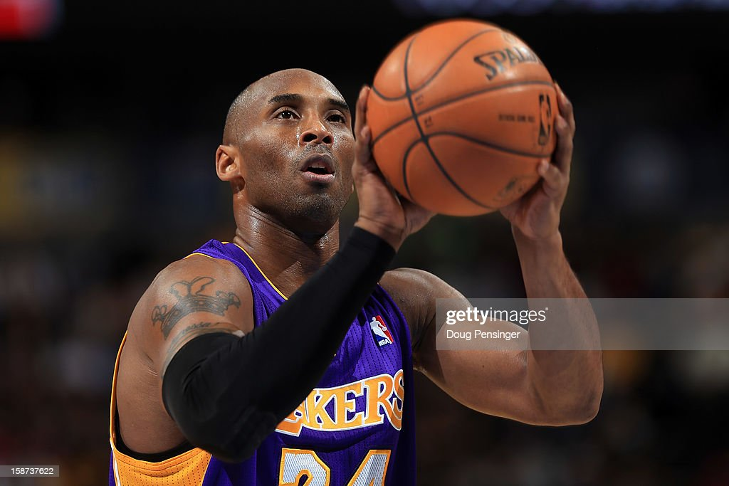 Kobe Bryant #24 of the Los Angeles Lakers takes a free throw against the Denver Nuggets at Pepsi Center on December 26, 2012 in Denver, Colorado. The Nuggets defeated the Lakers 126-114.