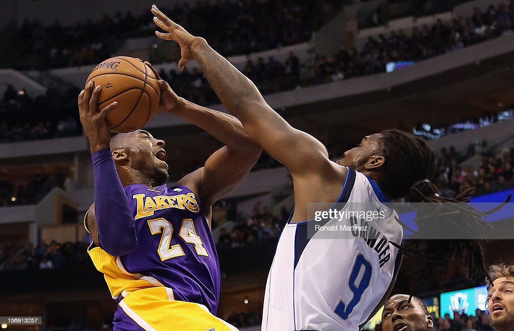 Kobe Bryant #24 of the Los Angeles Lakers takes a shot against Jae Crowder #9 of the Dallas Mavericks at American Airlines Center on November 24, 2012 in Dallas, Texas.