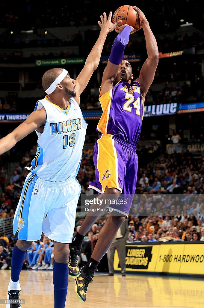 Kobe Bryant of the Los Angeles Lakers takes a shot over Corey Brewer of the Denver Nuggets at the Pepsi Center on February 25 2013 in Denver Colorado...