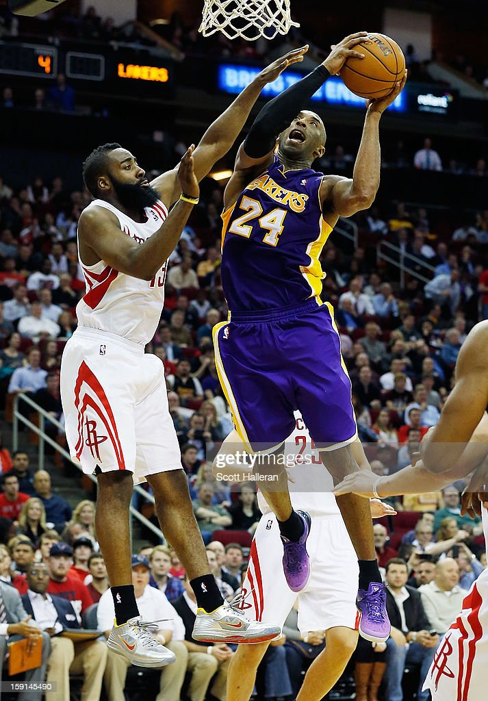 Kobe Bryant #24 of the Los Angeles Lakers takes a shot over James Harden #13 of the Houston Rockets at Toyota Center on January 8, 2013 in Houston, Texas.