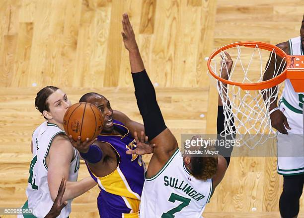 Kobe Bryant of the Los Angeles Lakers takes a shot over Jared Sullinger of the Boston Celtics during the first quarter at TD Garden on December 30...
