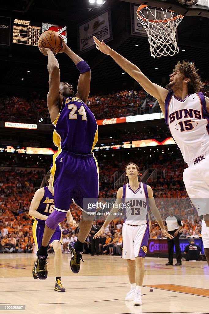 Kobe Bryant of the Los Angeles Lakers takes a shot over Robin lopez of the Phoenix Suns in the second quarter of Game Three of the Western Conference...