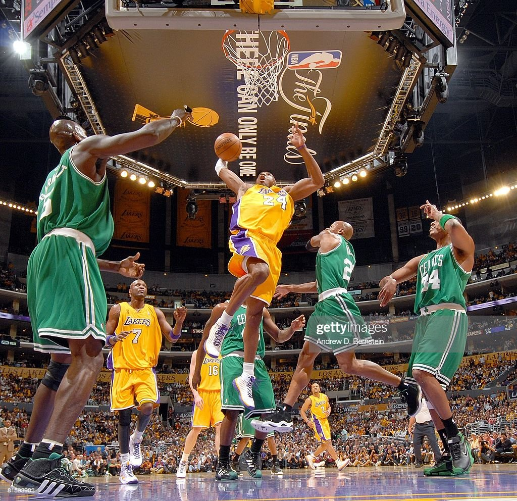 Kobe Bryant of the Los Angeles Lakers takes the ball to the basket against Kevin Garnett Ray Allen and Paul Pierce of the Boston Celtics in Game...