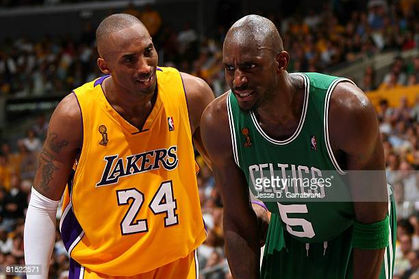 Kobe Bryant of the Los Angeles Lakers talks to Kevin Garnett of the Boston Celtics in Game Three of the 2008 NBA Finals on June 10 2008 at Staples...