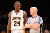 Kobe Bryant of the Los Angeles Lakers talks to referee Joe Crawford in Game One of the Western Conference Quarterfinals against the Utah Jazz during...