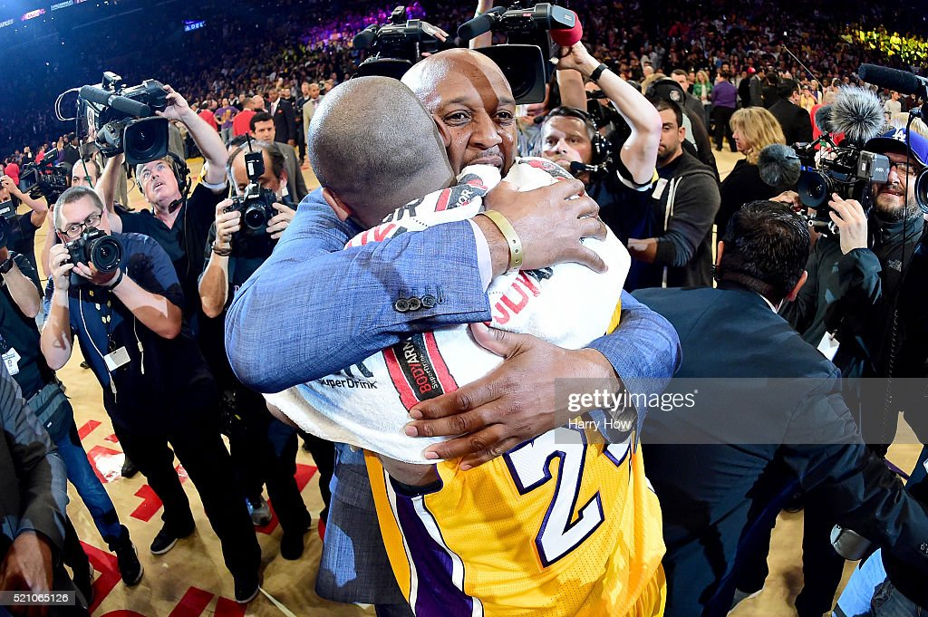 Kobe Bryant of the Los Angeles Lakers talks with former teammate Brian Shaw after scoring 60 points in his final NBA game at Staples Center on April...