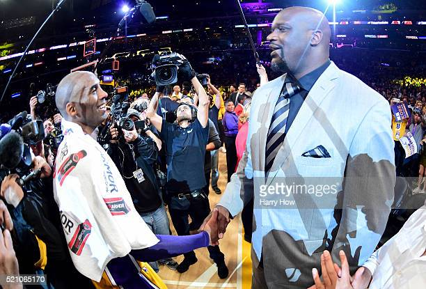 Kobe Bryant of the Los Angeles Lakers talks with former teammate Shaquille O'Neal after scoring 60 points in his final NBA game at Staples Center on...