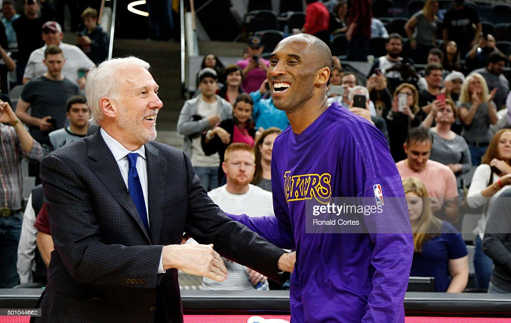 <a gi-track='captionPersonalityLinkClicked' href=/galleries/search?phrase=Kobe+Bryant&family=editorial&specificpeople=201466 ng-click='$event.stopPropagation()'>Kobe Bryant</a> #24 of the Los Angeles Lakers talks with head coach <a gi-track='captionPersonalityLinkClicked' href=/galleries/search?phrase=Gregg+Popovich&family=editorial&specificpeople=202904 ng-click='$event.stopPropagation()'>Gregg Popovich</a> of the San Antonio Spurs at the end of the game at AT&T Center on December 11, 2015 in San Antonio,Texas.